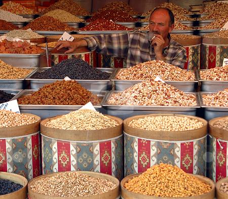Nuts seller stock photo, Turkish nuts seller in Ankara's market by Kobby Dagan