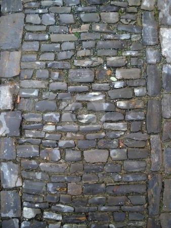 Cobblestone stock photo, Old gray medieval weathered cobblestone way in Germany. by Henrik Lehnerer