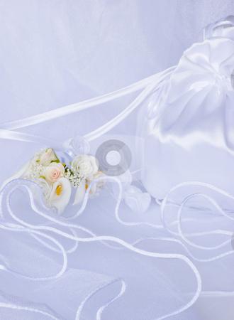 Wedding flowers and bridal bag over veil stock photo, Bridal bag wedding flowers decorations over bridal veil by Desislava Dimitrova