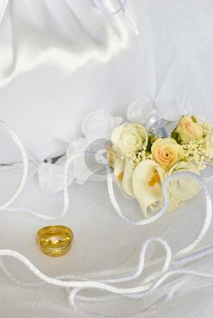 Wedding rings flowers and bridal bag over veil stock photo, Bridal bag and wedding rings flowers decorations over bridal veil by Desislava Dimitrova