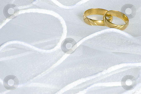 Wedding rings over veil stock photo, Wedding golden rings over bridal veil by Desislava Dimitrova