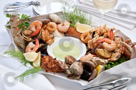 Seafood Feast stock photo, Seafood feast of shrimp, clams, crab. by Bill Robbins