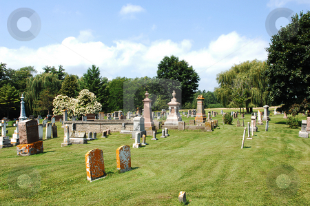 Very old cemetery. stock photo, An big very old cemetery in the country side, blue sky, white clouds. by Horst Petzold