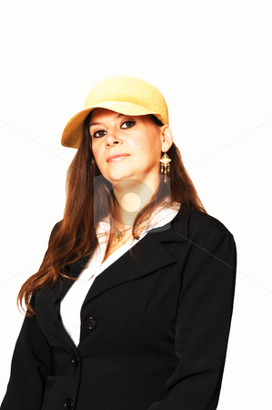 Woman with yellow hat. stock photo, A middle age woman sitting in the studio for an portrait in a black jacket