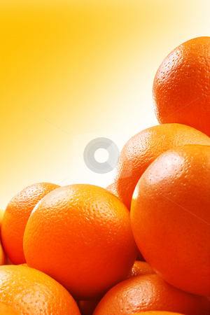 Oranges stock photo, Studio shot of group of oranges over gradient yellow background by iodrakon