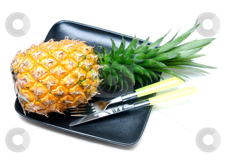 Pineapple stock photo, Ripe vivid pineapple on a black plate with knife and fork isolated over white by Francesco Perre