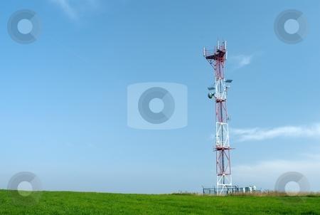 Telecom GSM tower stock photo, Telecom tower with a GSM reciever, transmitter by Juraj Kovacik