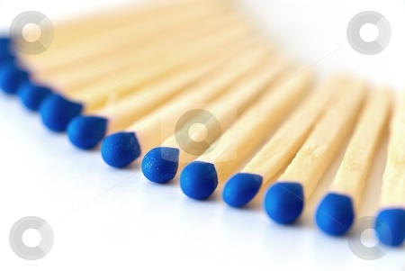 Blue matches stock photo, Detail fo matches with blue heads by Juraj Kovacik