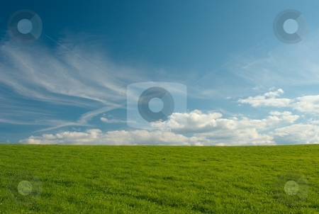 Summer meadow stock photo, Green meadow with blue sky and clouds by Juraj Kovacik