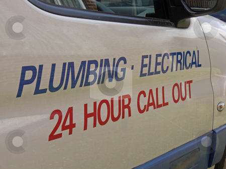 Sign on a van stock photo, 24 hour call out for plumbing and electrical emergence. by Ian Langley