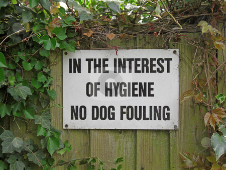 Dog fouling sign stock photo, Sign in a park warning owners to clean up dog excrement. by Ian Langley