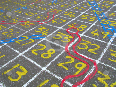 Snakes and ladders numbers game on a children's playground. stock photo, Snakes and ladders numbers game on a children's playground. by Stephen Rees
