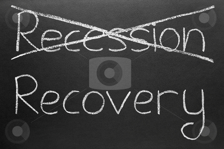 Crossing out recession and writing recovery. stock photo, Crossing out recession and writing recovery. by Stephen Rees