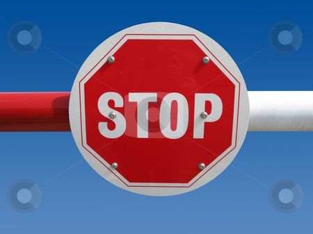 Red stop sign on a barrier. stock photo, Red stop sign on a barrier. by Stephen Rees