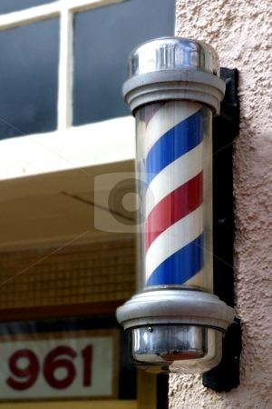 Barber Sign stock photo, Old red white and blue striped barber sign. by Henrik Lehnerer
