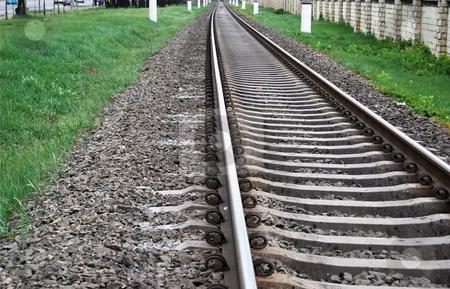 Railway stock photo, Direct rails in industrial suburb district by Leyla Akhundova