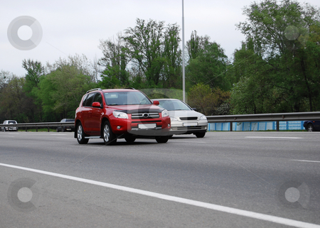 Highway stock photo, Red and silver cars driving on the highway by Leyla Akhundova