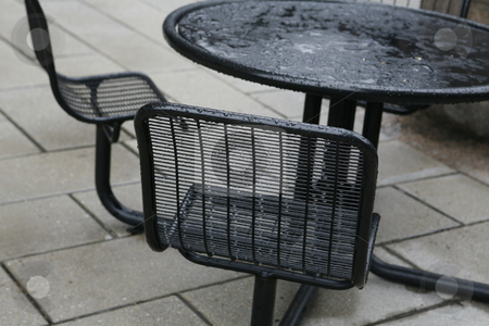 Metal Chairs with Raindrops stock photo, Metal chairs with raindrops by Terise Slotkin