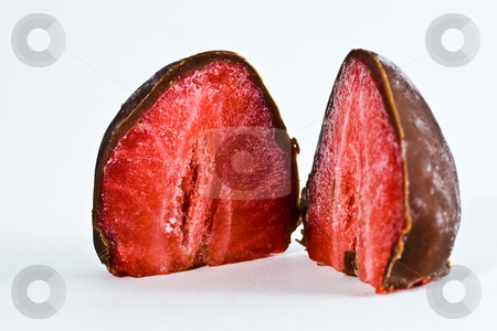 Two chocolate strawberries stock photo, Two chocolate strawberries isolated on plain white background by Damir Franusic