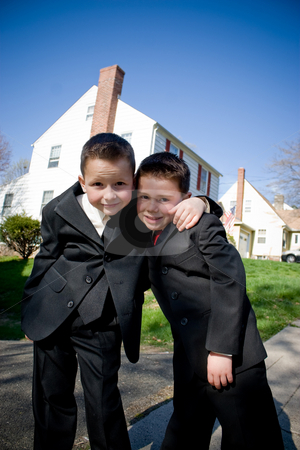 Two Happy Young Boys stock photo, Two happy young boys dressed in suits with smiles on their faces. by Todd Arena