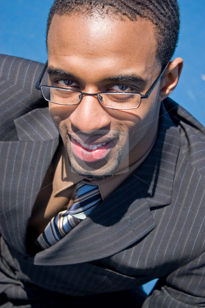 Black Business Man stock photo, African American man in a business suit with eye glasses smiling happily. by Todd Arena