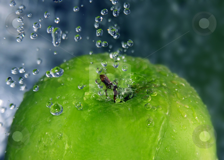 Refreshing apple stock photo, Water drops falling onto a green apple by Kirsty Pargeter