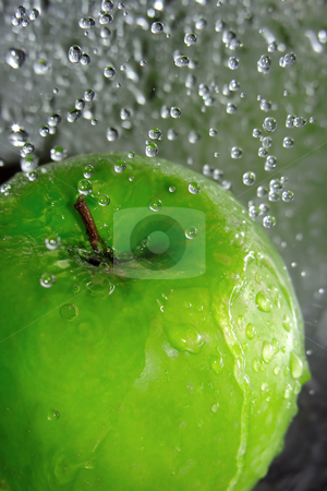 Apple splash stock photo, Water drops falling onto a green apple by Kirsty Pargeter