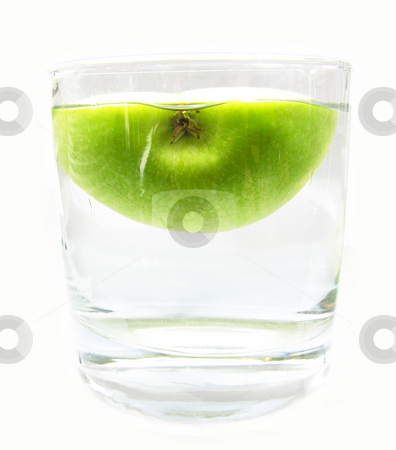 Half apple in glass of water stock photo,  by Kirsty Pargeter