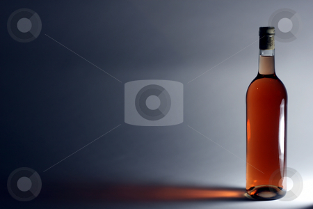 Ros? wine stock photo, A single bottle of Ros? wine in front of a light source by Jan Martin Will
