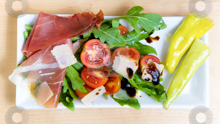 Antipasto stock photo, Antipasto served on a plate with salad, cheese and tomatoes by Jan Martin Will