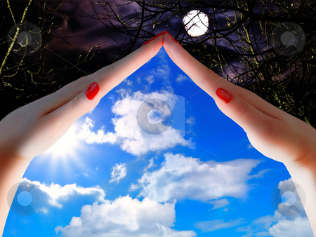 Day and night concept stock photo, Day and night concept with woman hands blue sky and moon by Sergej Razvodovskij