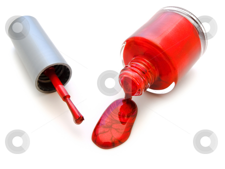 Nail varnish  stock photo, Brush for manicure and an inverted bottle of nail varnish by Sergej Razvodovskij