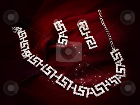 Necklace earrings at red fabric stock photo, Shiny necklace and earrings at red fabric by Sergej Razvodovskij