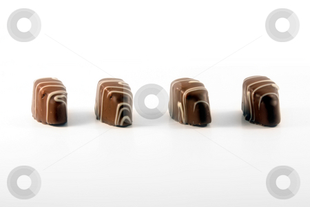 Chocolate stock photo, Chocolate against white background by Jan Martin Will