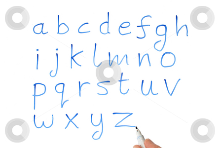 A teacher writing the alphabet on a whiteboard. stock photo, A teacher writing the alphabet on a whiteboard. by Stephen Rees