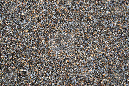Colorful stones on a beach. stock photo, Colorful stones on a beach. by Stephen Rees
