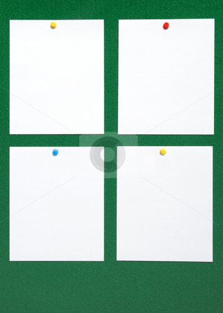 Four blank pieces of note paper. stock photo, Four blank pieces of note paper attached to a green felt notice board. by Stephen Rees