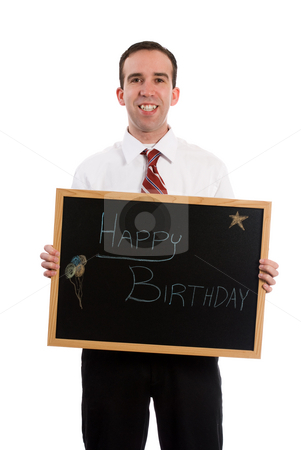 Happy Birthday stock photo, A young man wearing a suit is holding a sign that says happy birthday, isolated against a white background by Richard Nelson