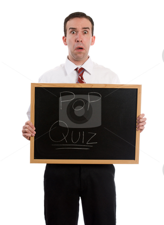 Pop Quiz stock photo, A young teacher holding a sign that says pop quiz, isolated against a white background by Richard Nelson