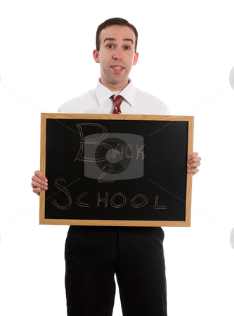 Back To School stock photo, A young teacher is holding up a small black board that read Back to School, isolated against a white background by Richard Nelson