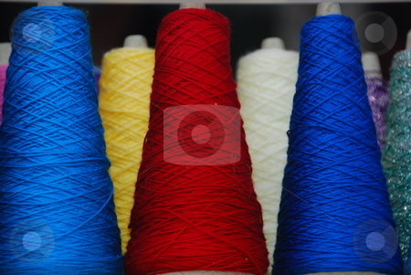 Spindle stock photo, Six differend colored spindles in red,blue,yellow and white by Wolfgang Zintl