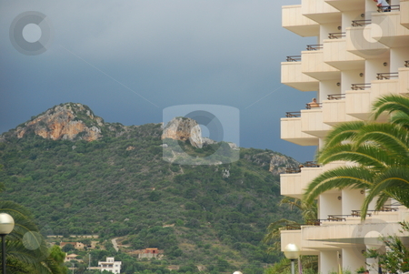 Apartment building on the island mallorca stock photo, Apartment building with palm trees and mountains in the background by Wolfgang Zintl