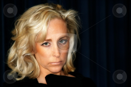 Blond Woman stock photo, Blond woman looking and posing on black background. by Henrik Lehnerer