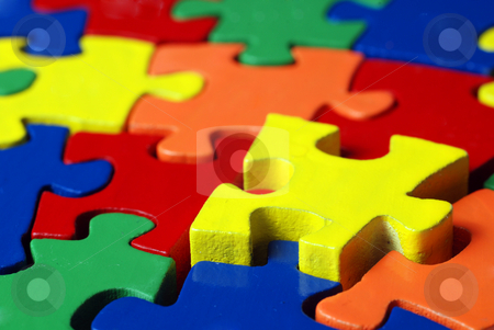 Colorful puzzle stock photo, The last puzzle piece coming down into it's place by Gjermund Alsos