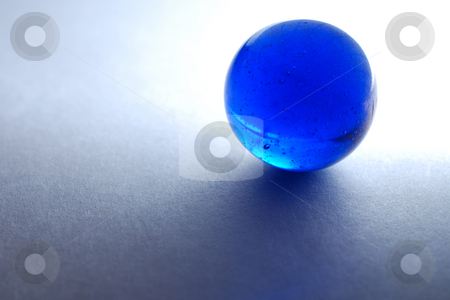 Blue marble stock photo, Backlit blue marble on white paper by Gjermund Alsos