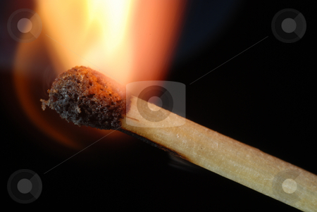 Igniting match stock photo, Close-up of igniting match isolated on black by Gjermund Alsos