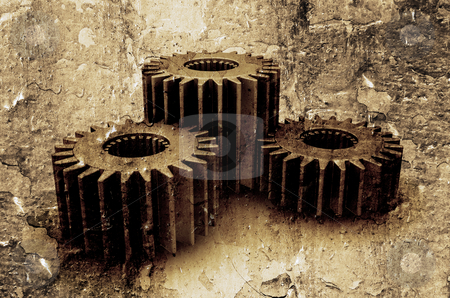 Grunge gears stock photo, Interlocking gears on textured grunge background by Kirsty Pargeter