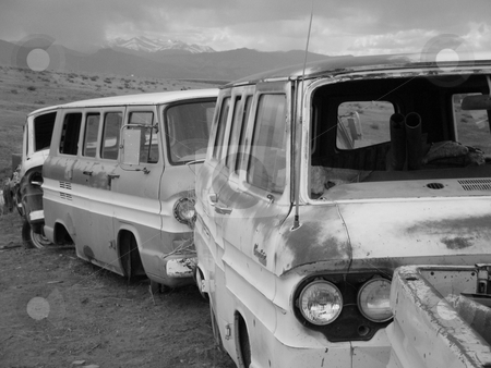 Rocky Mountain Traffic Jam stock photo, Line of junk vans with shadow of the majestic Rocky Mountains in the background. Near Loveland, Colorado. by James Spence