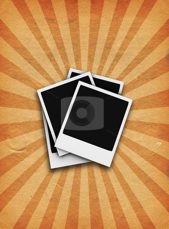 Grunge polaroids stock photo, Polaroids on grunge starburst background by Kirsty Pargeter