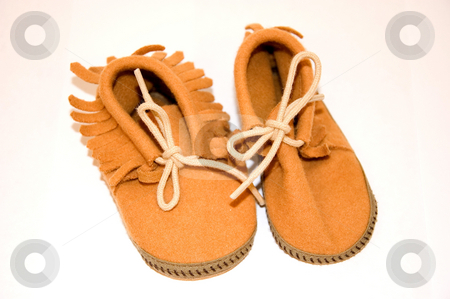 Pair of Baby Moccasins Shoes stock photo, This photo features a closeup pair of baby moccasin leather shoes with bow ties. by Valerie Garner